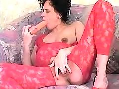 Pregnant lady plays with big dildo
